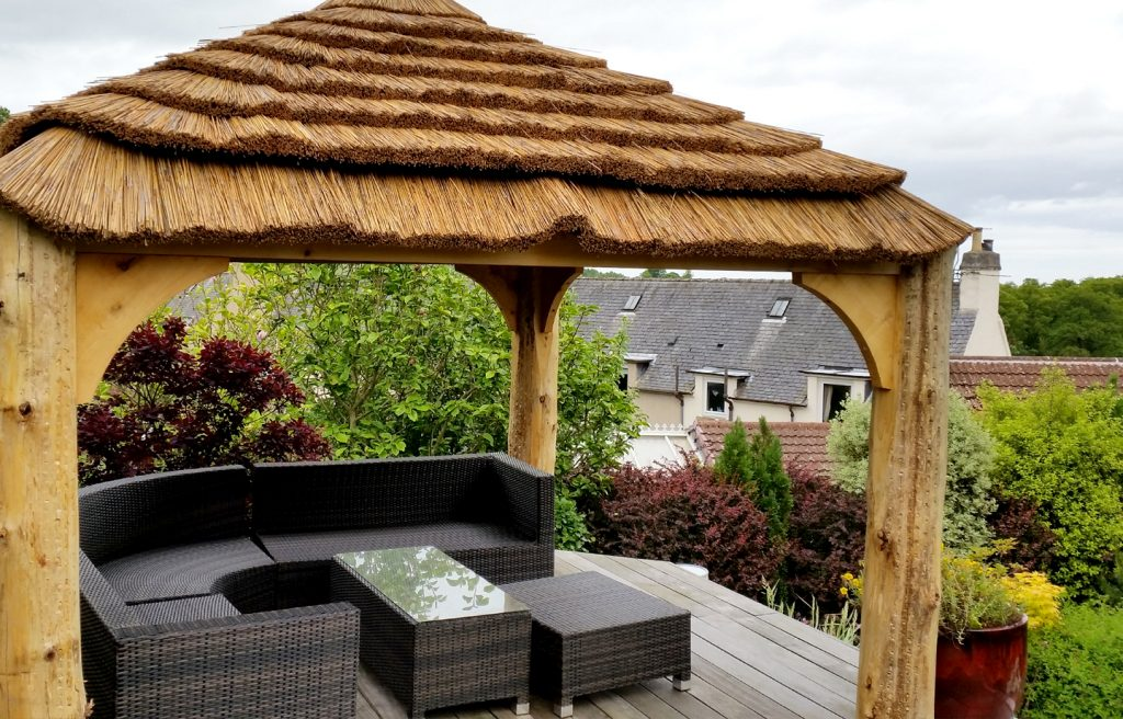 thatched gazebo with views roundwood timber framing