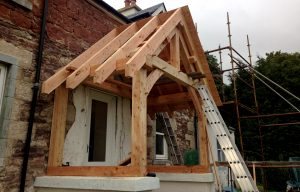 construction post and beam carpentry traditional joinery front porch extension
