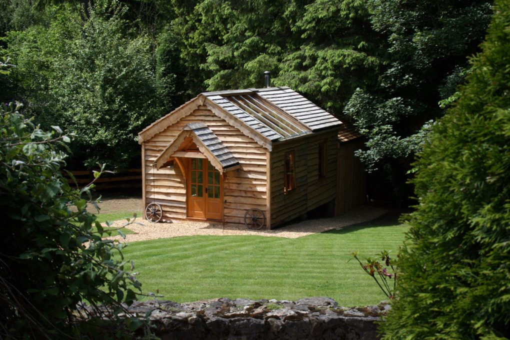 Cottage or chalet this is a complet wooden garden building with a skylight and wagon wheels