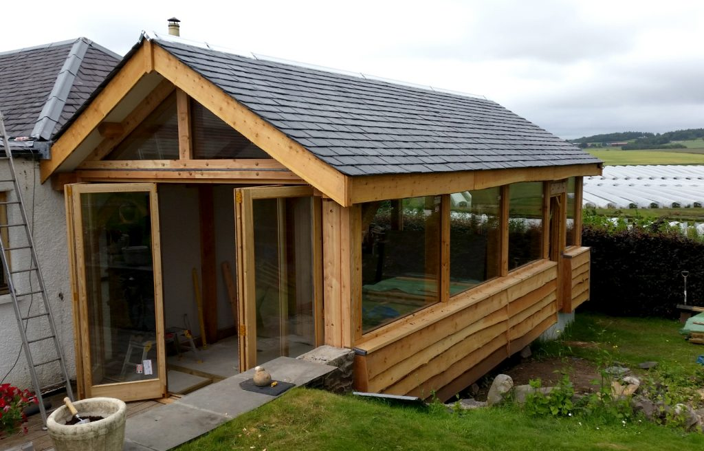 Timber extensions taypory slate roof and waney boards post and beam construction